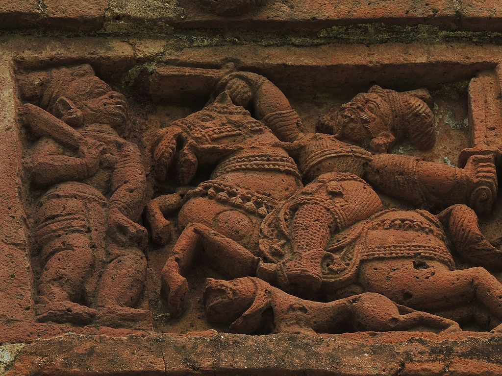 Figurines over the wall of jor bangla temple.jpg