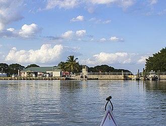Flamingo, Monroe County, Florida - Flamingo Marina from the Florida Bay entrance. Salt/fresh water dam, kayak launch pad, slips, and ranger boats are visible.
