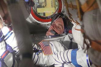Timothy Creamer - Creamer inside Soyuz TMA-17 spacecraft during launch dress rehearsal.
