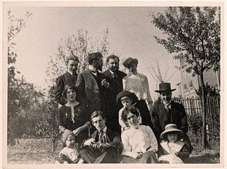"Paul Sordes - Meeting of artists at the Schmitts' residence in Saint-Cloud, circa 1910. Paul Sordes is in the back row, far left. From left to right, front row: Roger Haour, Maurice Ravel, Jeanne and Christiane Pivet. Second row: Jane Haour, ""Raton"" Schmitt, Léon Pivet; Back row: Sordes, Florent Schmitt, Léon-Paul Fargue, Jeanne Schmitt."