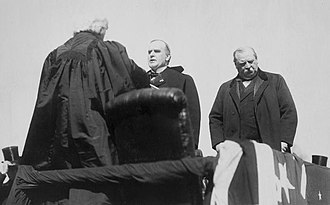 Melville Fuller - Chief Justice Fuller administering the oath to William McKinley as president in 1897. Outgoing president Grover Cleveland stands to the right.