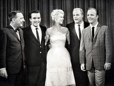 Palmer on I've Got a Secret with host Garry Moore and three of Bing Crosby's sons (1961) Garry Moore Betsy Palmer Crosby boys Ive Got a Secret 1961.JPG
