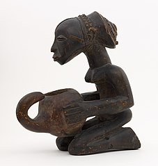 Kneeling female statue carrying a bowl (mboko)