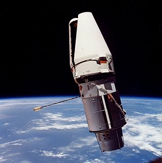 Payload fairing - The Augmented Target Docking Adapter in orbit, with its payload fairing still attached