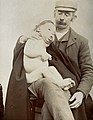 George Edward Shuttleworth holding a male child, showing sig Wellcome V0030003.jpg