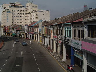Shophouse - A terraced layout allows a row of shophouses to extend as long as a city block permits, as exemplified by this long row of double storey shophouses at Penang Street, George Town, Penang.