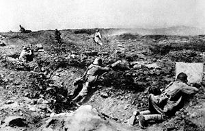 A small unit of French troops assaults a Germa...