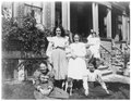 Girls and a dog posed in front of house on Alfred Street, Kingston (I0013442).tif