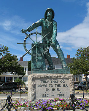 Ship's wheel - Iconic image of a helmsman at a ship's wheel: the Gloucester Fisherman's Memorial.