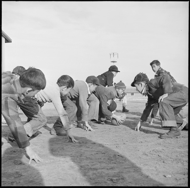 File:Granada Relocation Center, Amache, Colorado. Grade school boys playing touch football during the re . . . - NARA - 539109.tif