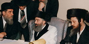 Yitzhak Aharon Korff - Korff (center) in his study with cousins including Rabbi Yitzhak Twersky (left) and Grand Rabbi Shlomo Goldman