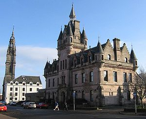 Scottish baronial architecture - Greenock Sheriff Court displays crow-stepped gables and corbelled corner turrets.