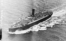 Black and white photo of a large boat with a single funnel at sea