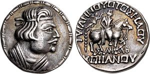 "Heraios - Silver tetradrachm of Kushan king Heraios (1-30 CE) in Greco-Bactrian style. Obv: Bust of Heraios, with Greek royal headband. Rev: Horse-mounted King, crowned with a wreath by the Greek goddess of victory Nike. Greek legend: ΤΥΡΑΝΝΟΥΟΤΟΣ ΗΛΟΥ - ΣΑΝΑΒ - ΚΟϷϷΑΝΟΥ ""The Tyrant Heraios, Sanav (meaning unknown), of the Kushans""."