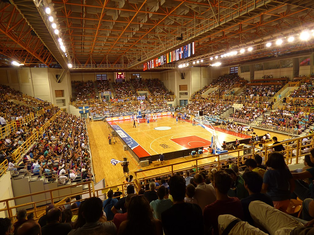 http://upload.wikimedia.org/wikipedia/commons/thumb/6/67/Heraklion_Indoor_Sports_Arena_interior.jpg/1024px-Heraklion_Indoor_Sports_Arena_interior.jpg