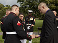 Honorary Marine Daran Wankum, right, receives Eagle Globe and Anchor pins from Marines of Marine Barracks Washington following a wreath laying ceremony at the Marine Corps War Memorial in Arlington, Va, June 13 130613-M-KS211-026.jpg