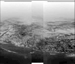 Lakes of Titan - Image of Titan taken during ''Huygens''' descent, showing hills and topographical features that resemble a shoreline and drainage channels.