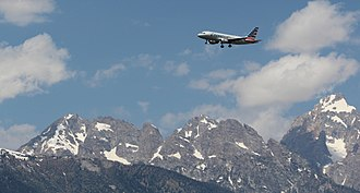 Jackson Hole Airport - An American A319 approaching the airport with the Grand Teton range in view.