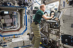 ISS-46 Tim Kopra sets up hardware for the BASS-M experiment in the Destiny lab.jpg