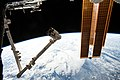 ISS-59 Canadarm2 robotic arm and solar arrays above the South Pacific Ocean.jpg