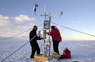 McMurdo Sound - Weather instruments such as this device installed upon Iceberg B-15A provide scientists a better understanding of Antarctica's impact upon global climate. Photograph by: Josh Landis. National Science Foundation