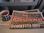 Ilta-Sanomat on board an aeroplane.jpg