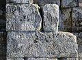 Inscripción en el arco de Cáparra (32099357326).jpg