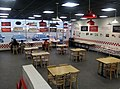 Interior of Five Guys, Middletown, NY, with tables space for social distancing during COVID-19 pandemic.jpg