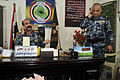 Iraqi Police Col. Hadi Hashish receives a phone call while meeting with U.S. Soldiers to discuss security and coordination concerns in the Basrah province at the Shat Al Arab District Headquarters in Tannumal 110313-A-WO967-009.jpg