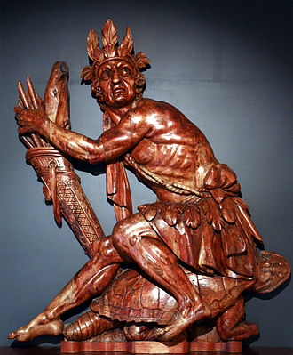 Iroquois mythology - 19th-century decoration of an unidentified ship: Iroquois Indian sitting on a turtle, in reference to the Great Turtle that carries the Earth in Iroquois mythology. By the sculpture workshop of Brest, France naval arsenal.
