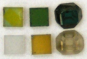 Diamond enhancement - Pure diamonds, before and after irradiation and annealing. Clockwise from left bottom: 1) Initial (2×2 mm) 2-4) Irradiated by different doses of 2-MeV electrons 5-6) Irradiated by different doses and annealed at 800 °C.
