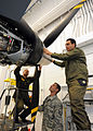 Italian air force Chief Warrant Officer Lorenzo Scafuto, right, and Staff Sgt. Marco Redavide, center, work together on an MQ-9 Reaper aircraft while receiving instructions from U.S. Air Force Master Sgt. Scott 110920-F-IF667-043.jpg