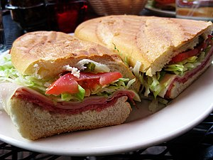 Panini (sandwich) - A typical panini with salami, mortadella, tomatoes and lettuce