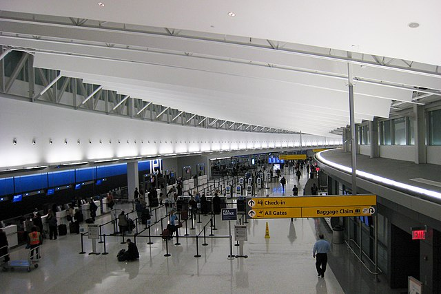 JFK Terminal 5 By Doug Letterman [CC BY 2.0 (http://creativecommons.org/licenses/by/2.0)], via Wikimedia Commons