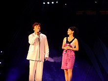 Jackie Chan and a female singer 1.jpg