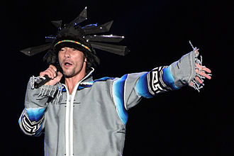 Jay Kay - Kay wearing a headdress during a concert