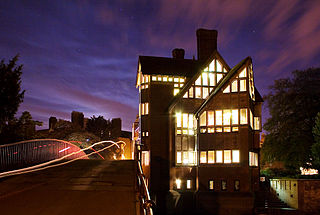 The Jerwood Library of Trinity Hall, Cambridge. The trail of lights over the bridge are from the lamps of passing cyclists. Designed by the architects Freeland Rees Roberts, the library backs onto the River Cam and was opened in 1999.