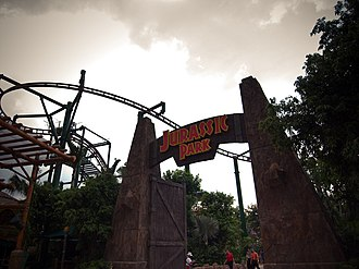 Canopy Flyer - The entrance to the Jurassic Park sub area of The Lost World showcasing Canopy Flyer in the background.