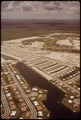 KENDALE LAKES HOUSING DEVELOPMENT IS CONSTRUCTED NEAR THE BOUNDARIES OF THE EVERGLADES NATIONAL PARK - NARA - 544600.tif