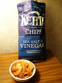 A bag and bowl of Kettle Foods sea salt and vinegar-flavored potato chips.