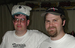 "Kevin Lipsitz - ""Krazy"" Kevin Lipsitz (left) and Mike ""Top Dog"" Leonard pose together after the two competed at a Nathan's Famous qualifier at Zoo Atlanta in 2002."