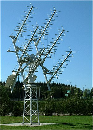 Turnstile antenna - High gain axial mode Yagi turnstile array used to communicate with weather satellites on 136-137 MHz at Bedu, Belgium.  Each of the 6 components of the array consists of two 9-element Yagi antennas mounted on the same axis at right angles and fed in quadrature to radiate a narrow beam of circularly polarized radio waves