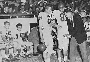 1957 Houston Cougars football team - Houston's Bob Borah and Bob Blevins confer with head coach Hal Lahar at Mississippi Veterans Memorial Stadium against Ole Miss