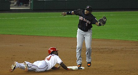 Lastings Milledge steals a base. Lastings Milledge and Luis Castillo.jpg