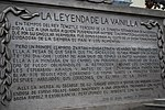 Plaque behind statue with Totonac legend of how vanilla came to be in Papantla, Mexico
