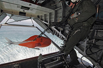 HM-15 - An aircrew member from HM-15 on a MK-103 mine sweeping mission aboard an MH-53E near Bahrain