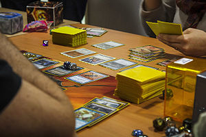Collectible card game - Players engaged in a game of Magic: The Gathering