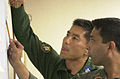 Maj. Tsuyoshi Ishida of Japan and Squadron Leader Shaheed Al-mamun, Bangladesh Air Force calculates drop zone targets in preparation of Pacific Airlift Rally 2001 010911-F-GY993-100.jpg
