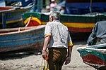 Man Amongst the Boats (7151225215).jpg