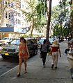 Manhattan east side pedestrians walking September midday women and trees.jpg